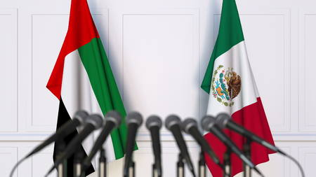 Flags of the UAE and Mexico at international meeting or conference. 3D rendering