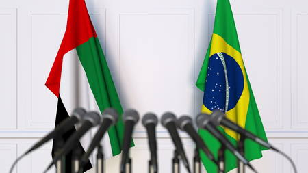 Flags of the UAE and Brazil at international meeting or conference. 3D rendering