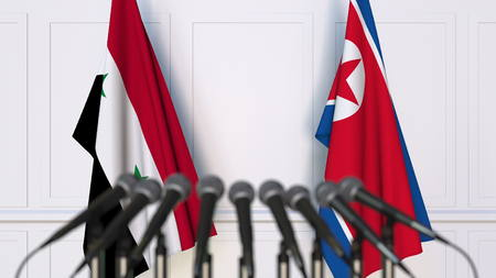 Flags of Syria and North Korea at international meeting or conference. 3D rendering Stock Photo
