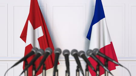 Flags of Switzerland and France at international meeting or conference. 3D rendering Foto de archivo