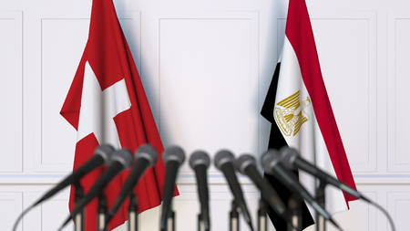 Flags of Switzerland and Egypt at international meeting or conference. 3D rendering Stock Photo
