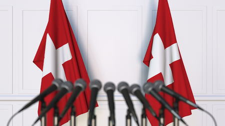Swiss official press conference. Flags of Switzerland and microphones. Conceptual 3D rendering