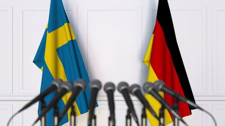 Flags of Sweden and Germany at international meeting or conference. 3D rendering Stock Photo