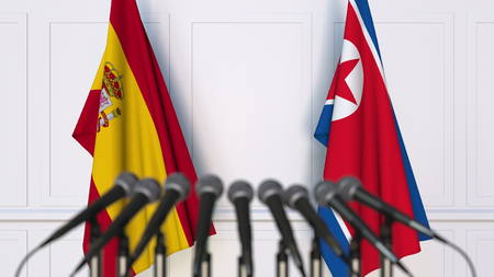 Flags of Spain and North Korea at international meeting or conference. 3D rendering