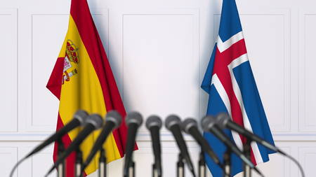 Flags of Spain and Iceland at international meeting or conference. 3D rendering