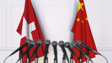 Flags of Switzerland and China at international meeting or conference. 3D Stock Photo