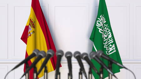Flags of Spain and Saudi Arabia at international meeting or conference. 3D rendering Stock Photo