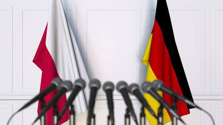 Flags of Poland and Germany at international meeting or conference. 3D rendering