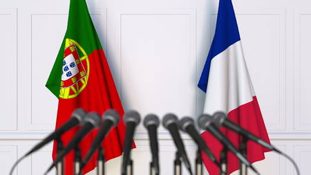 Flags of Portugal and France at international meeting or conference. 3D rendering Stock Photo