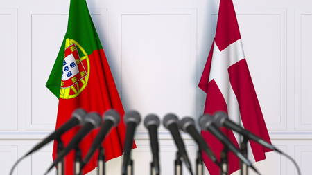 Flags of Portugal and Denmark at international meeting or conference. 3D rendering