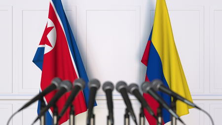 Flags of North Korea and Colombia at international meeting or conference. 3D rendering