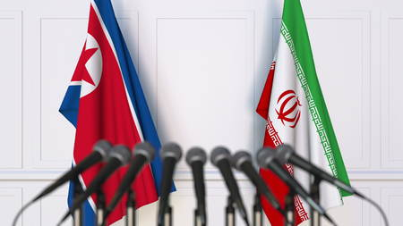 Flags of North Korea and Iran at international meeting or conference. 3D rendering Stock Photo