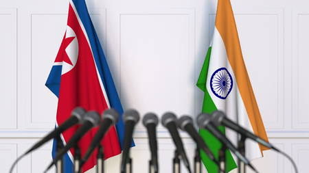 Flags of North Korea and India at international meeting or conference. 3D rendering