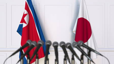 Flags of North Korea and Japan at international meeting or conference. 3D rendering Stock Photo