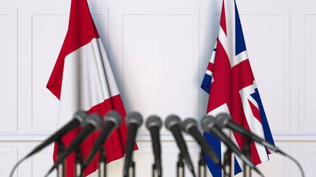 Flags of Peru and The United Kingdom at international meeting or conference. 3D rendering