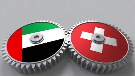 Flags of the UAE and Switzerland on meshing gears. International cooperation conceptual 3D rendering Stock Photo