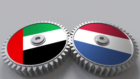Flags of the UAE and Netherlands on meshing gears. International cooperation conceptual 3D rendering