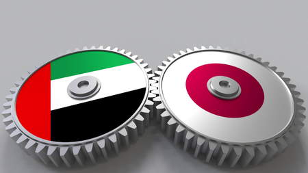 Flags of the UAE and Japan on meshing gears. International cooperation conceptual 3D rendering