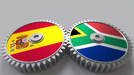 Flags of Spain and South Africa on meshing gears. International cooperation conceptual 3D rendering