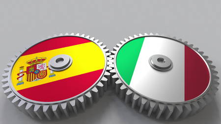 Flags of Spain and Italy on meshing gears. International cooperation conceptual 3D rendering