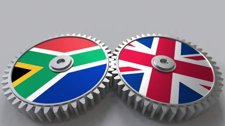 Flags of South Africa and The United Kingdom on meshing gears. International cooperation conceptual 3D rendering