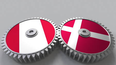 Flags of Peru and Denmark on meshing gears. International cooperation conceptual 3D rendering Stock Photo