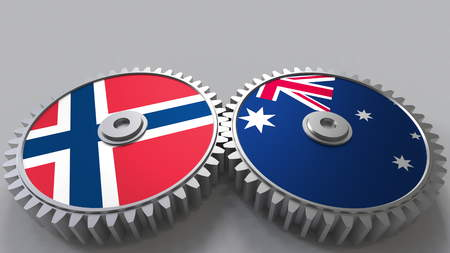 Flags of Norway and Australia on meshing gears. International cooperation conceptual 3D rendering Stock Photo