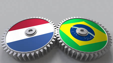 Flags of the Netherlands and Brazil on meshing gears. International cooperation conceptual 3D rendering