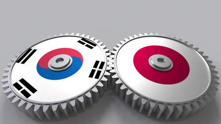 Flags of South Korea and Japan on meshing gears. International cooperation conceptual 3D rendering