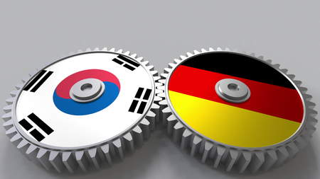 Flags of South Korea and Germany on meshing gears. International cooperation conceptual 3D rendering