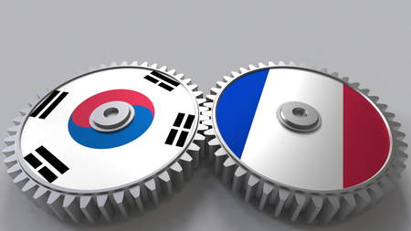 Flags of South Korea and France on meshing gears. International cooperation conceptual 3D rendering