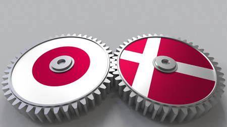 Flags of Japan and Denmark on meshing gears. International cooperation conceptual 3D rendering Stock Photo
