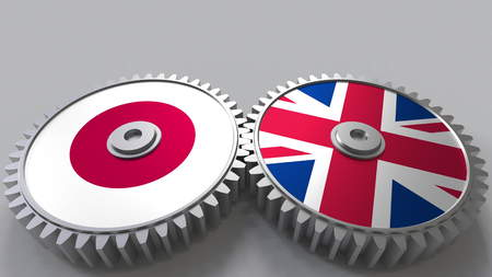Flags of Japan and The United Kingdom on meshing gears. International cooperation conceptual 3D rendering Stock Photo