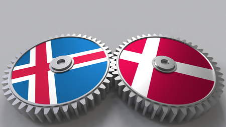 Flags of Iceland and Denmark on meshing gears. International cooperation conceptual 3D rendering Stock Photo