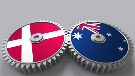 Flags of Denmark and Australia on meshing gears. International cooperation conceptual 3D rendering