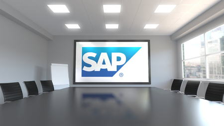 SAP SE logo on the screen in a meeting room. Editorial 3D rendering Editorial