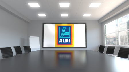 Aldi logo on the screen in a meeting room. Editorial 3D rendering