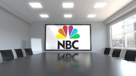 National Broadcasting Company NBC logo on the screen in a meeting room. Editorial 3D rendering