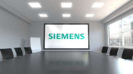 Siemens logo on the screen in a meeting room. Editorial 3D rendering Editoriali