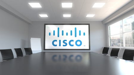 Cisco Systems logo on the screen in a meeting room. Editorial 3D rendering