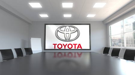 Toyota logo on the screen in a meeting room. Editorial 3D rendering Editoriali