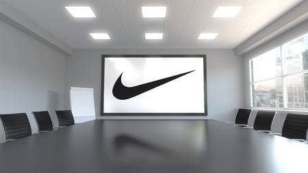 Nike inscription and logo on the screen in a meeting room. Editorial 3D rendering Editorial