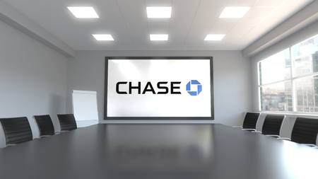 JPMorgan Chase Bank logo on the screen in a meeting room. Editorial 3D rendering