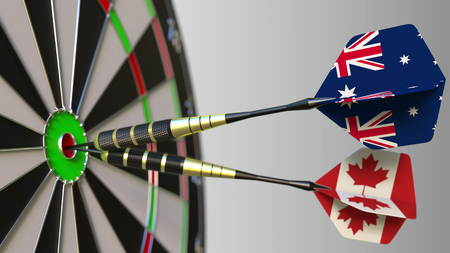 Flags of Australia and Canada on darts hitting bullseye of the target. International cooperation or competition conceptual 3D rendering