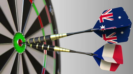 Flags of Australia and France on darts hitting bullseye of the target. International cooperation or competition conceptual 3D rendering Stock Photo