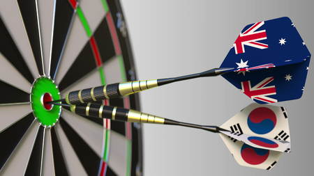 Flags of Australia and Korea on darts hitting bullseye of the target. International cooperation or competition conceptual 3D rendering