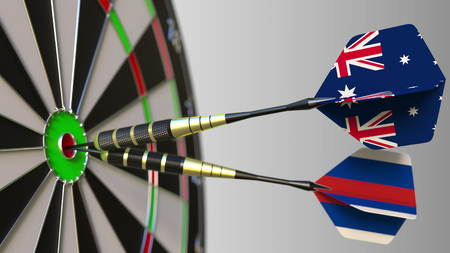 Flags of Australia and Russia on darts hitting bullseye of the target. International cooperation or competition conceptual 3D rendering Stock Photo