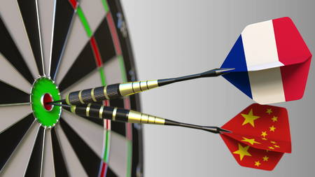 Flags of France and China on darts hitting bullseye of the target. International cooperation or competition conceptual 3D rendering Stock Photo