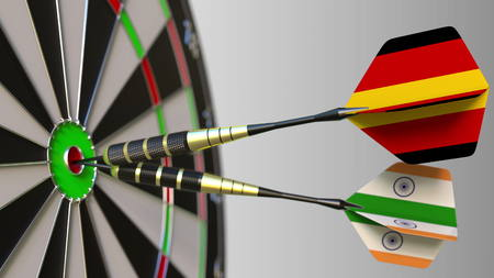 Flags of Germany and India on darts hitting bullseye of the target. International cooperation or competition conceptual 3D rendering