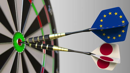 Flags of the European Union and Japan on darts hitting bullseye of the target. International cooperation or competition conceptual 3D rendering